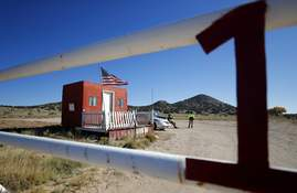 Associated Press Security staffers stand guard Friday at Bonanza Creek Ranch in Santa Fe, N.M., the site of a fatal film accident.