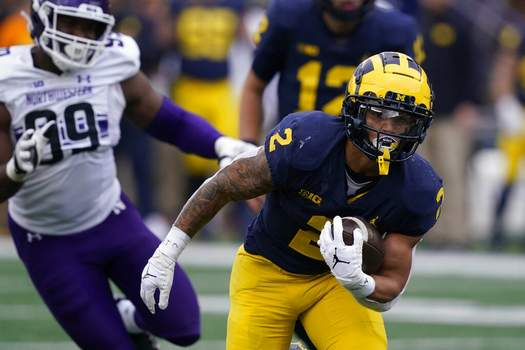 Carlos Osorio | Associated PressMichigan running back Blake Corum (2) rushes during the first half of an NCAA college football game against Northwestern, Saturday, in Ann Arbor, Mich.